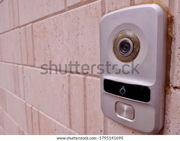 video door phone fixed in the entrance of a house /door cameras are mostly used to prevent crimes and to identify criminals after any mishap/security cameras are required for private protection