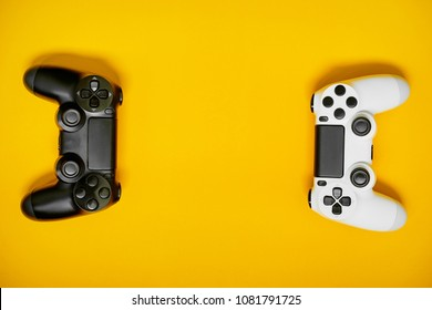 Video game competition. Gaming concept. White and black joystic on yellow backround.