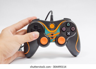 Video game console controller on hand white background