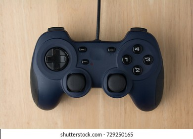 Video Game Controller on Wood Background Top View