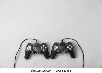 Video game controllers on light background