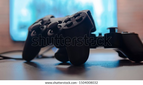Video game controllers on the table