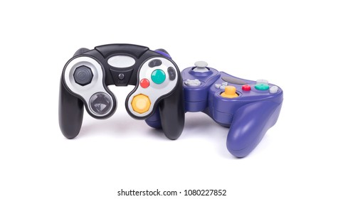 Video game controllers on white background with clipping path
