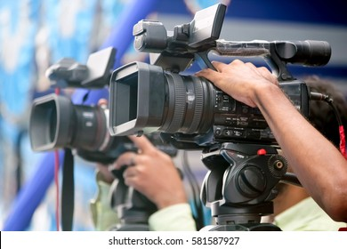 Video journalist holding camera