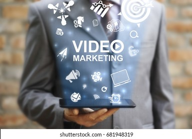 Video Marketing Online Business concept. Man represent tablet computer with video marketing icon on virtual screen.