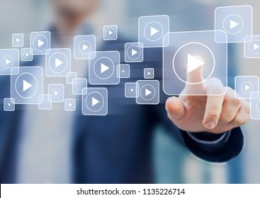 Video on demand technology with person touching play button on virtual screen to watch online VOD streaming of movie or TV