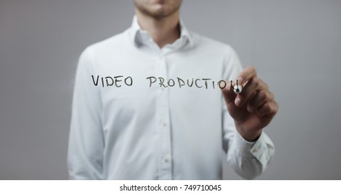 Video production , Man Writing on Glass
