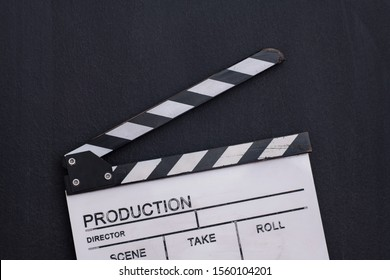 video production movie clapper cinema action and cut concept on balck chalkboard background