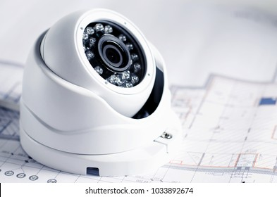 Video security equipment and blueprint on a table. Soft focus photo Good for security service engineering company site or advertising