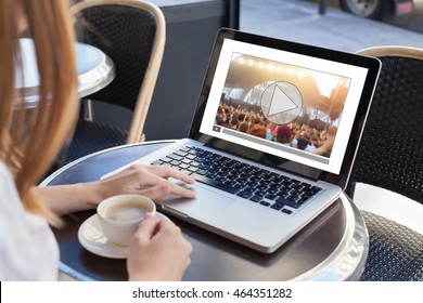video streaming, online concert, woman watching live music clip on internet on laptop in cafe