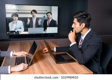 Videoconferencing in meeting room.