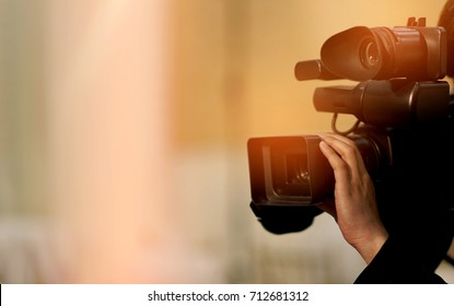 videographer close up / cameraman / movie / professional camera / man with camera