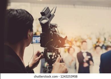 videographer close up, cameraman, man with camera, movie,