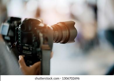 videographer close up, cameraman, movie, man with camera, movie, professional camera