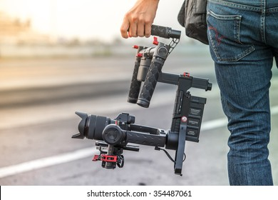 Videographer with gimball video dslr, Professional video, Videographer in event.