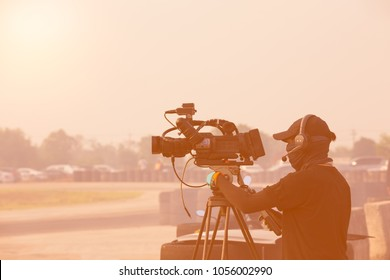 videographer staff Prepare Photographer video recording activity with in the event racing track and evening scene