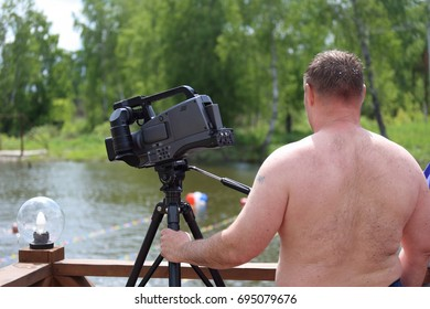 The videographer is sunbathing. June 2017, Russia: Camera operator makes a reportage
