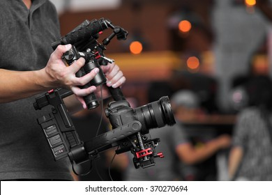 Videographer using steady cam, Professional equipment helps to make high quality video