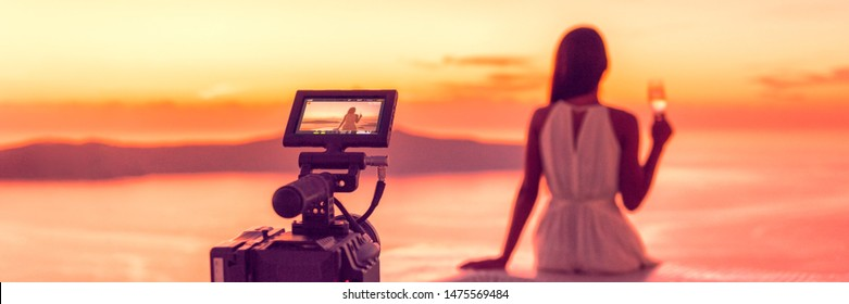 Videography professional video camera shoot behind the scene shooting at sunset scene banner panorama, luxury travel. Professional videography equipment shooting in summer destination.