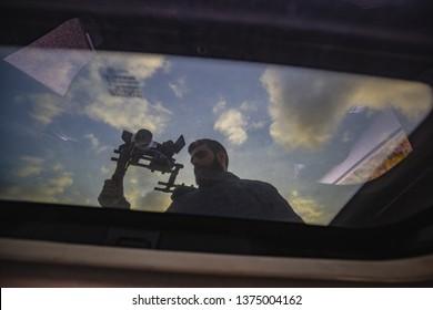 Videomaker in cameracar scene