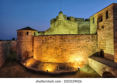 VIDIN, BULGARIA - AUGUST 10, 2017: Baba Vida medieval castle by night, illuminated with colored spotlights