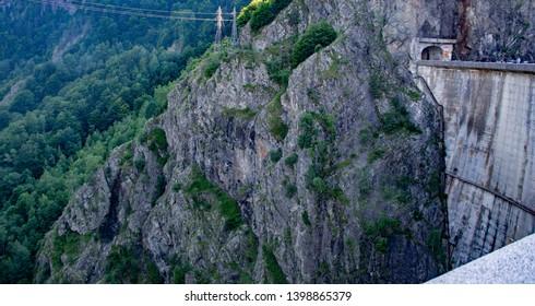 Vidraru Dam, Romania July, 4th, 2018. Vidraru Damis adaminRomania. Situated between Frunţii and Ghiţu mountains Built on Argeş Riverand createsLake Vidraru.