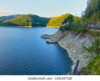 Vidraru lake is an artificial lake in Romania. It was created in 1965 by the construction of the Vidraru Dam on the Argeș River. It lies in the shadow of the Fagaras Mountains