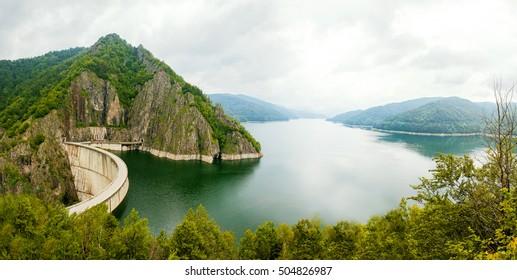 Vidraru Lake (Lacul Vidraru) and Dam in Carpathian Mountains, Fagaras ridge, Romania panorama.