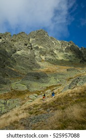 Vidrieros, Spain - October 8, 2016: Mountaineers ascending a steep mountain before the first snowfall. The Curavacas peak is a mountain in Palencia province. Spain,