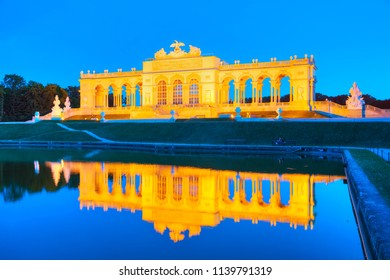 VIENNA - AUGUST 29: Gloriette Schonbrunn at sunset with tourists on August 29, 2017 in Vienna. It's the largest gloriette in Vienna built in 1775.