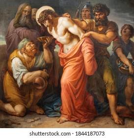 VIENNA, AUSTIRA - OCTOBER 22, 2020: The painting Jesus clothes are taken away in church St. Johann der Evangelist by Karl Geiger (1876).