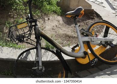 vienna, austria - 01 01 2019 - ofo bike in vienna with burnt down wheel because of vandalismn. ofo bike is bankrupt