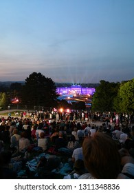 Vienna , Vienna /Austria; 05/31/2018: a concert of the Vienna Philharmonic filled with people in front of an illuminated palace