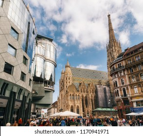Vienna, Austria, 1 October, 2017: St Stephen's church and surrounding modern buildings Haas Haus with many tourists in Stephansplatz