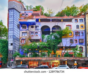 VIENNA, AUSTRIA - 1 October 2018: Hundertwasser house, Hundertwasserhaus - apartment house, idea and concept of Austrian artist Friedensreich Hundertwasser. Colorful facade with growing trees, Autumn