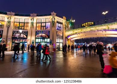 Vienna, Austria - 1.12.2018: Vienna prater park, Austria. Night scene from the famous tourist destination. Funny atraction, big Vienna wheel and giant roller coaster.