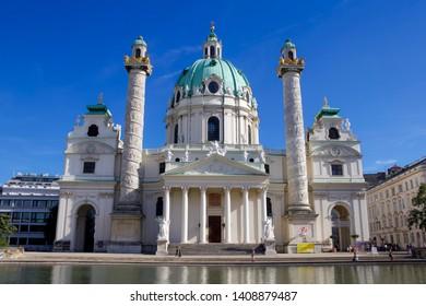 """VIENNA, AUSTRIA: 12 August 2018 - """"Karlskirche"""" Baroque Church with Water in Front"""