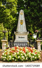Vienna, Austria - 12.07.2013: Beethoven's tombstone among trees in Vienna Central Cemetery.