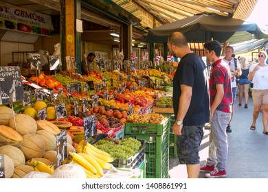 VIENNA, AUSTRIA: 13 August 2019 - People Viewing a Fruit Stall at the Famous Naschmarkt