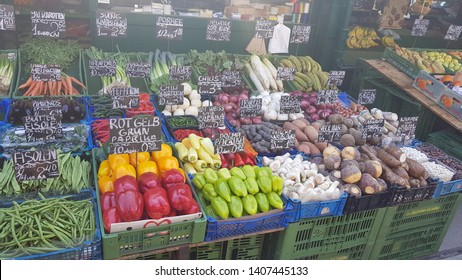 Vienna / Austria - 18 April 2018: Naschmarkt, Vienna Market during the day with tulips, produces, and other goods.