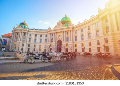 Vienna, Austria - 19.08.2018: Horse-drawn carriage or Fiaker, popular tourist attraction, on Michaelerplatz in Vienna.