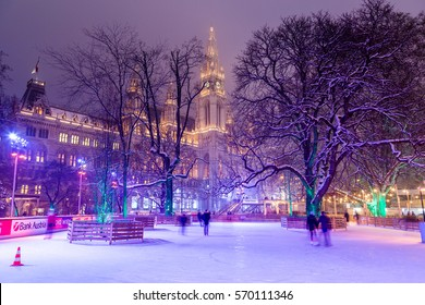 VIENNA, AUSTRIA - 1ST FEB 2017: Wiener Eistraum (Vienna Ice World) at Rathausplatz in the winter. Rathaus (City Hall) can be seen in the distance.