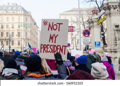 VIENNA, AUSTRIA - 21ST JAN 2017. Large amounts of people and a #NOT MY PRESIDENT  sign at a protest in Vienna over Donald Trumps presidency