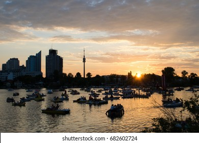VIENNA, AUSTRIA - 22 JULY 2017: Unidentified people participate in Lichterfest 2017, the annual boat and light event on the Alte Donau of Vienna