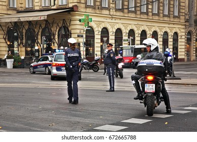 VIENNA. AUSTRIA. 23 OCTOBER 2012 : Police accompany demonstrators at  Ring Road in Vienna. Austria
