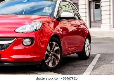 VIENNA, AUSTRIA, 28 SEPTEMBER 2016, OPEL ADAM on the street. Red city car hatchback Opel Adam.