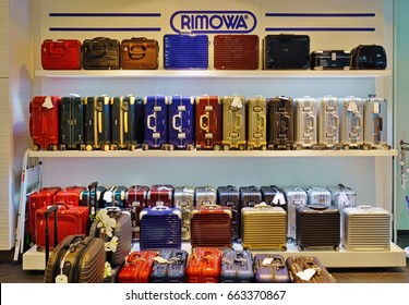 VIENNA, AUSTRIA -3 JUN 2017- Display of colorful metal suitcases in an airport Rimowa store. Rimowa is a German company known for its sturdy aluminum and polycarbonate sturdy carry-on luggage.
