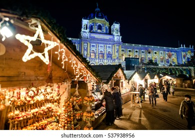 VIENNA, AUSTRIA - 6 DECEMBER 2016: People visiting Maria Theresa Square (Platz) Christmas Market. Focus in the back.