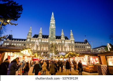 VIENNA, AUSTRIA - 6 DECEMBER 2016: People visiting the Christmas Market in Vienna park and City Hall (Rathaus), Austria,Vienna