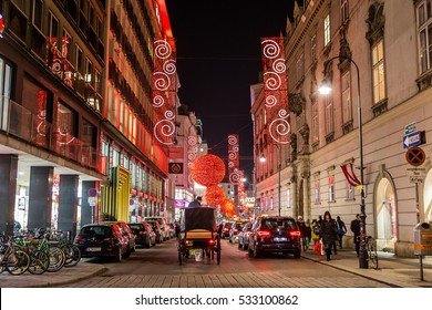 VIENNA, AUSTRIA - 6TH DECEMBER 2016: A view along Rotenturmstrasse in Vienna at Christmas. A Fiaker and people can be seen.